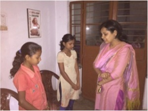 Aashima prays with rescued girls